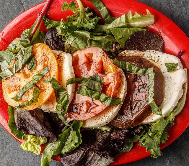 The weather has us on a salad binge... Our caprese (heirloom tomatoes, fresh mozzarella, mixed greens, a light vinaigrette and ribbons of basil leaves) is a great preamble to May's Spicy Shrimp and Bacon pizza special, AND, it all goes really well with $1.50 domestic bottles. #HappyMonday