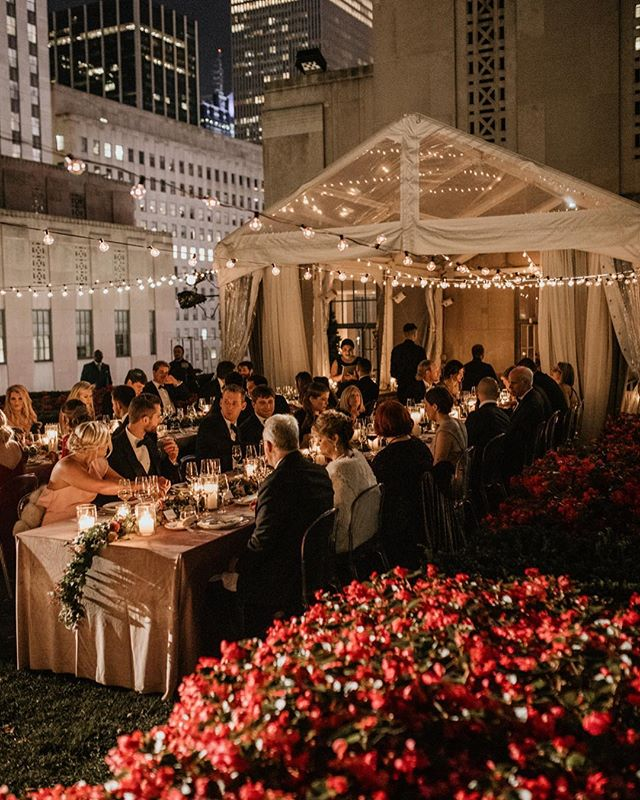 It's hard to imagine a more idyllic wedding reception than this wedding at @620loftgarden: dining on a Manhattan rooftop under some bistro lights on a warm autumn night. We can't wait to do another event in this space! . . Photo: @kateedwardsweddings Venue: @620loftgarden Planning: @atayloredaffair Florals: @hellabloom Catering: @creativeedgeparties . . #lnjwedding #lnjweddings #manhattanweddings #nycweddings #rooftopwedding #weddingreception #bistrolights #weddinglighting #weddingdesign #eventdesign #outdoorwedding