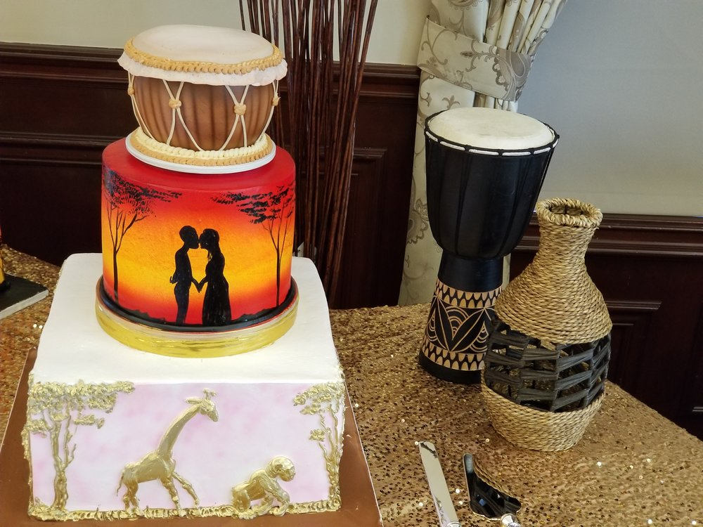 The gorgeous wedding cake with accent decor.