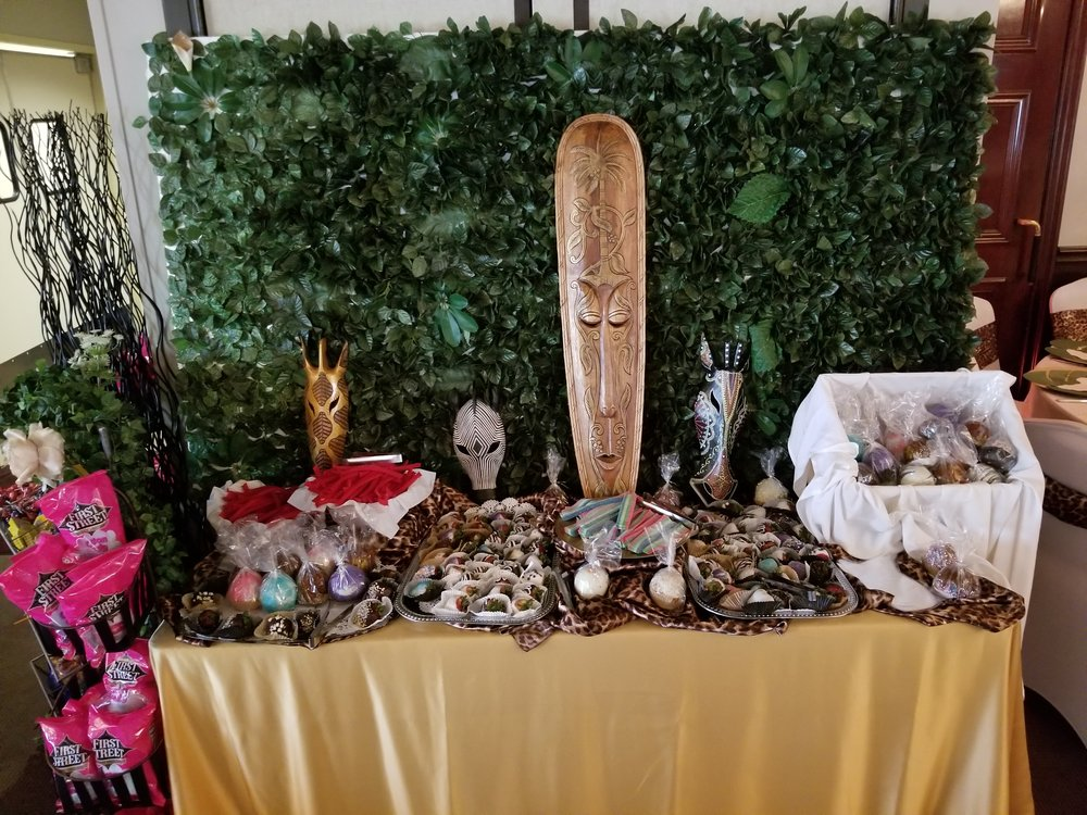 We created a sweets table fit for Royalty. Complete with chocolate covered strawberries, candied apples, and cotton candy.