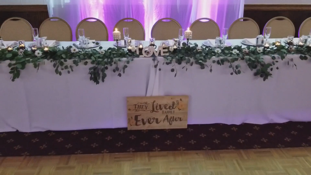 The elegant and sweet head table.