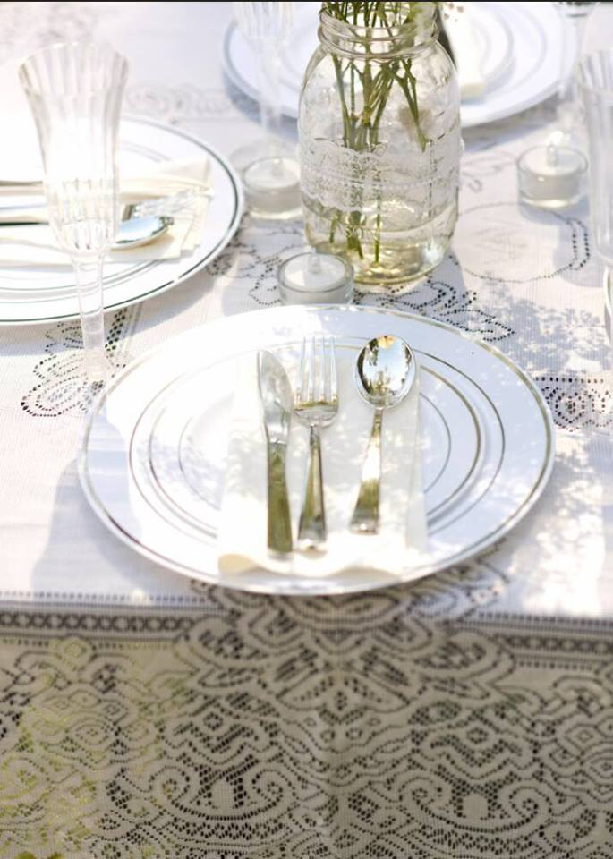 The place settings were created using plastic (yes plastic) plates and utensils. Not all that glitters is gold.