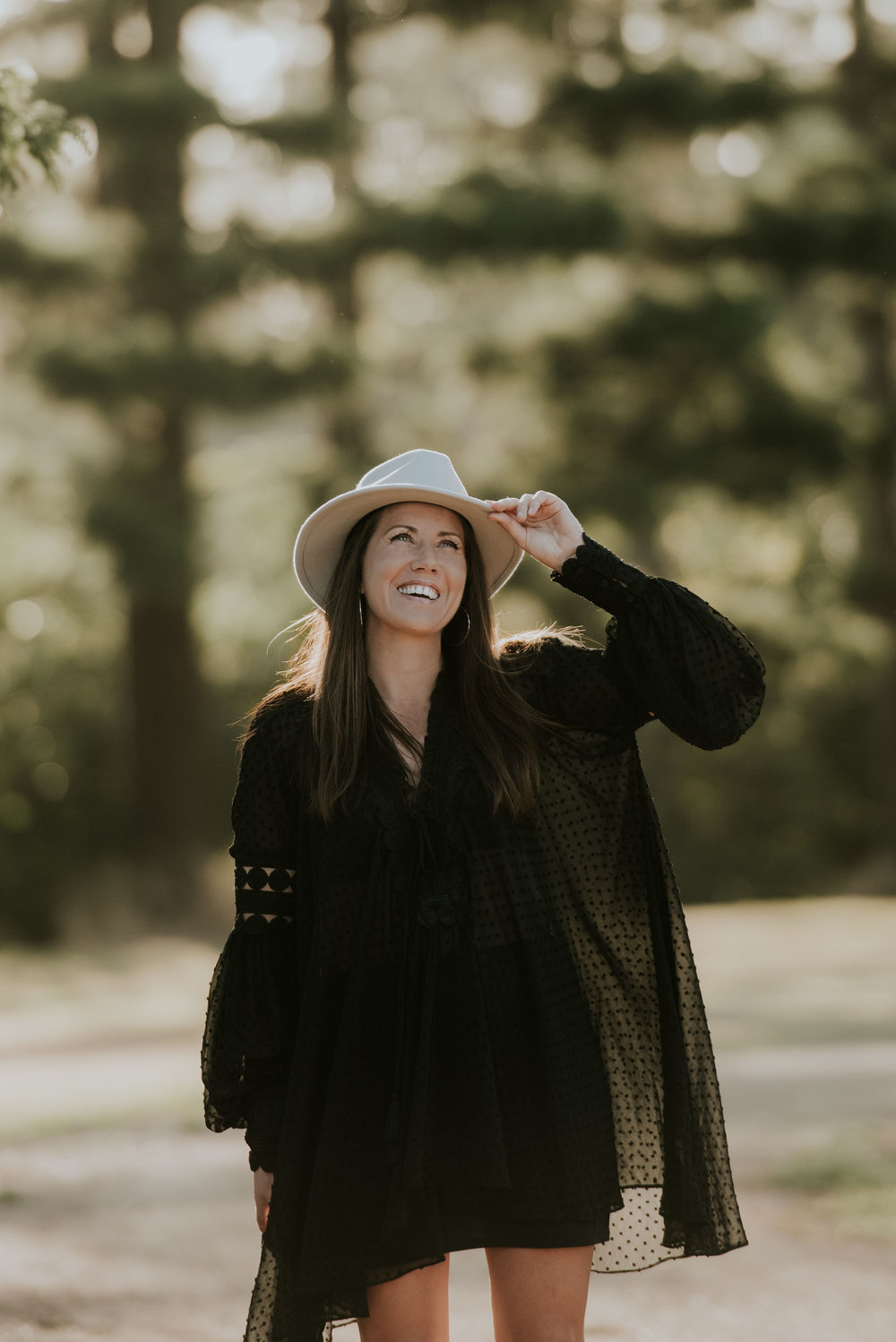 Hi there, thanks for wandering by! - I'm Laurie, the main lady behind The Wedding Wanderer. I'm a marriage celebrant, wedding stylist and founder of The White Dress Movement. Everything I do here is underpinned by a philosophy of creating unique, bohemian experiences that wholeheartedly reflect your love story, but also have the purpose of paying it forward.