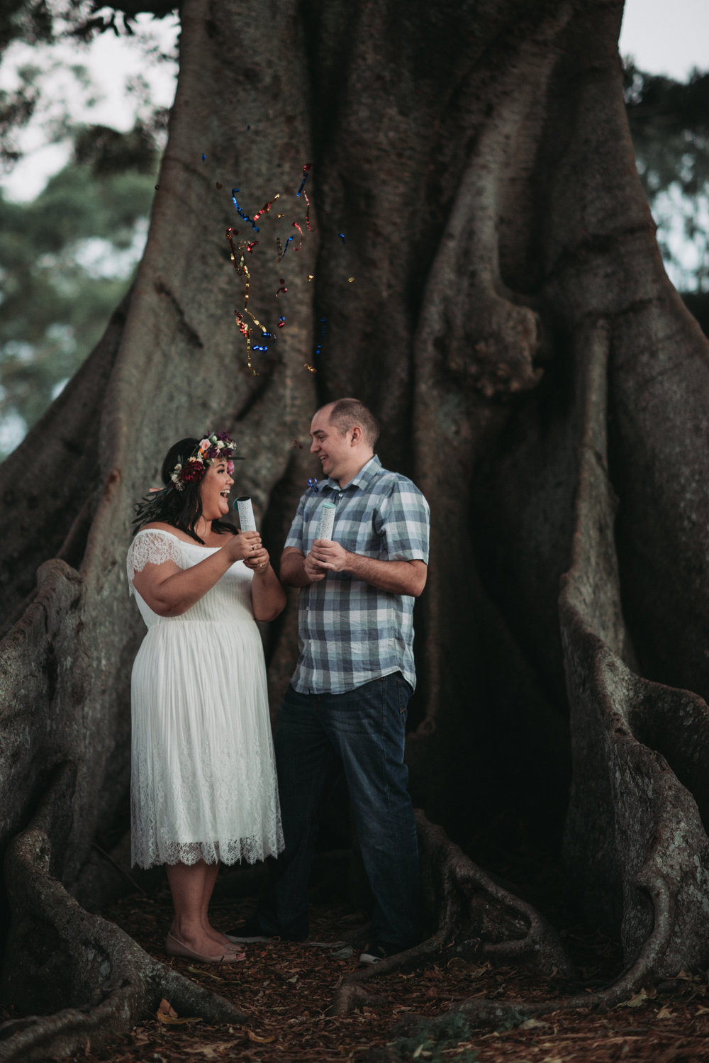 Engagement Photoshoot Inspiration Brisbane Wedding Photography Confetti Popper Bright Flowers Bouquet Floral Crown Old Petrie Town Lovelenscapes Photography www.lovelenscapes.com