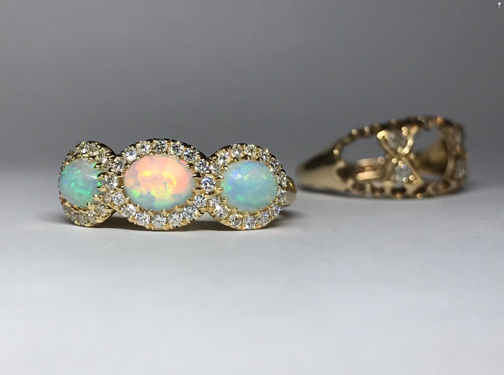 Three opals removed from a tired early 20th century ring, transformed into a triple cluster and instantly more wearable!