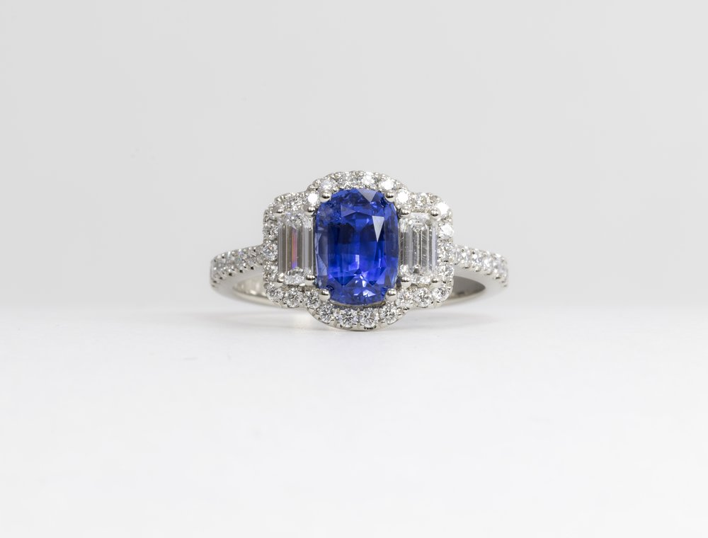 Round and baguette cut diamond and oblong cushion cut sapphire triple cluster ring. Made in Chichester, England.