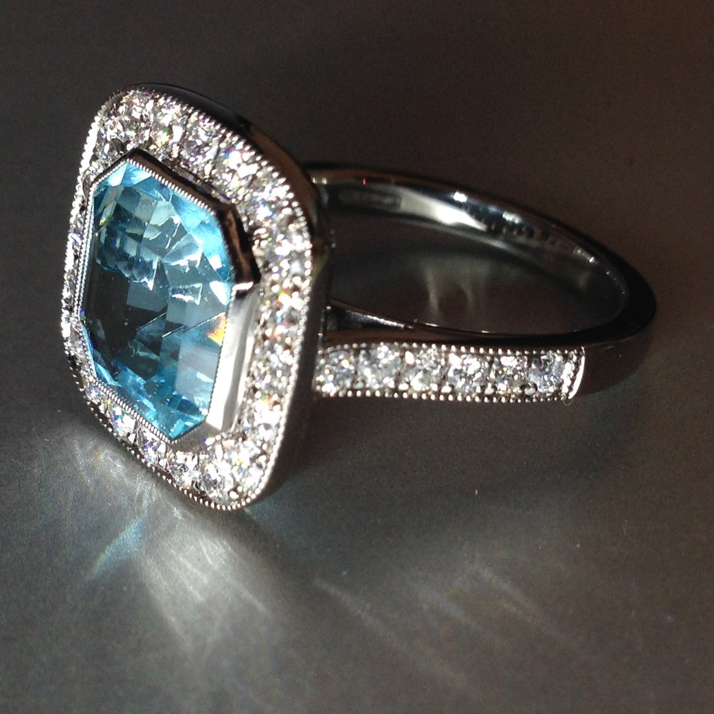 Aquamarine and diamond cluster ring made for a London jeweller. Made in Chichester, England.