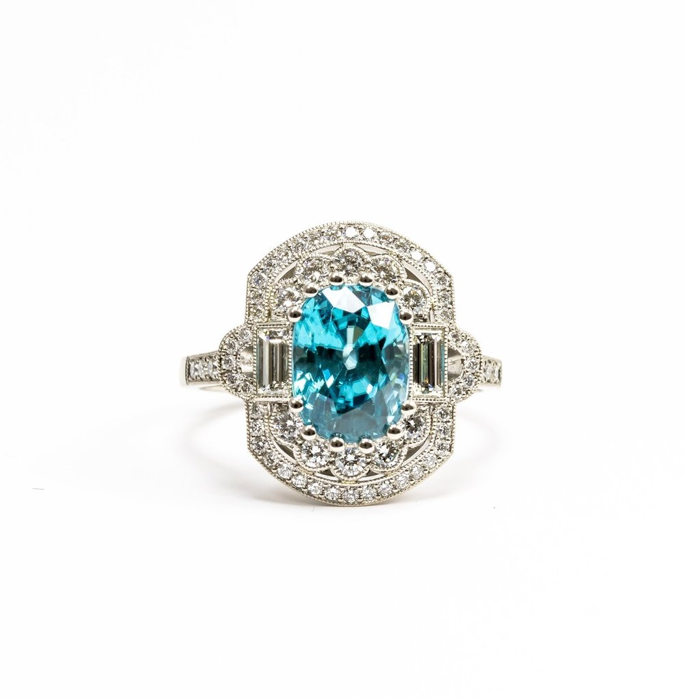 Diamond and blue Zircon art deco style cluster ring. Made in Chichester, England.