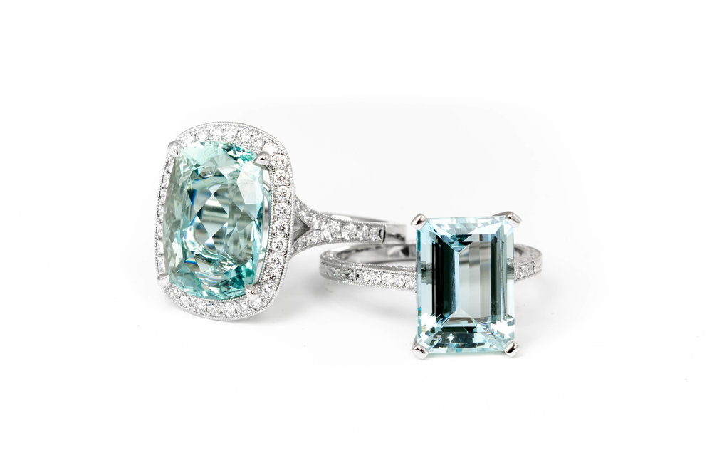 Cushion cut aquamarine and diamond cluster ring. Aquamarine and diamond ring with hand engraved shoulder decoration. Made in Chichester, England.