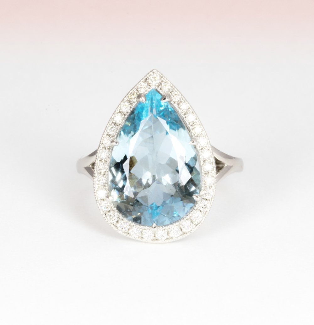 Pear shaped aquamarine and diamond cluster ring. Made in Chichester, England.