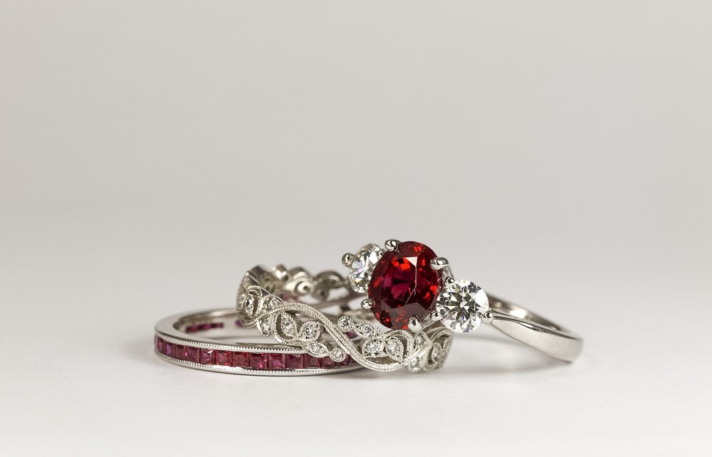 Ruby and Diamond Three Stone Ring in Platinum The central oval cut ruby (1.83ct) has been certified by GPL (certificate number 11557) has been set with four claws between two modern round brilliant cut diamonds.