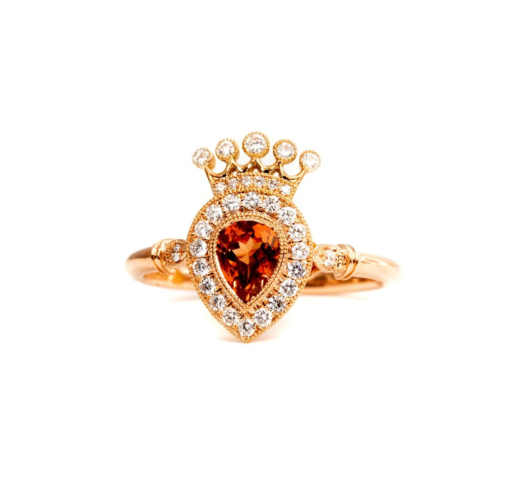 18ct rose gold mounted 0.80ct orange sapphire pear shaped cluster ring. Made in Chichester, England.