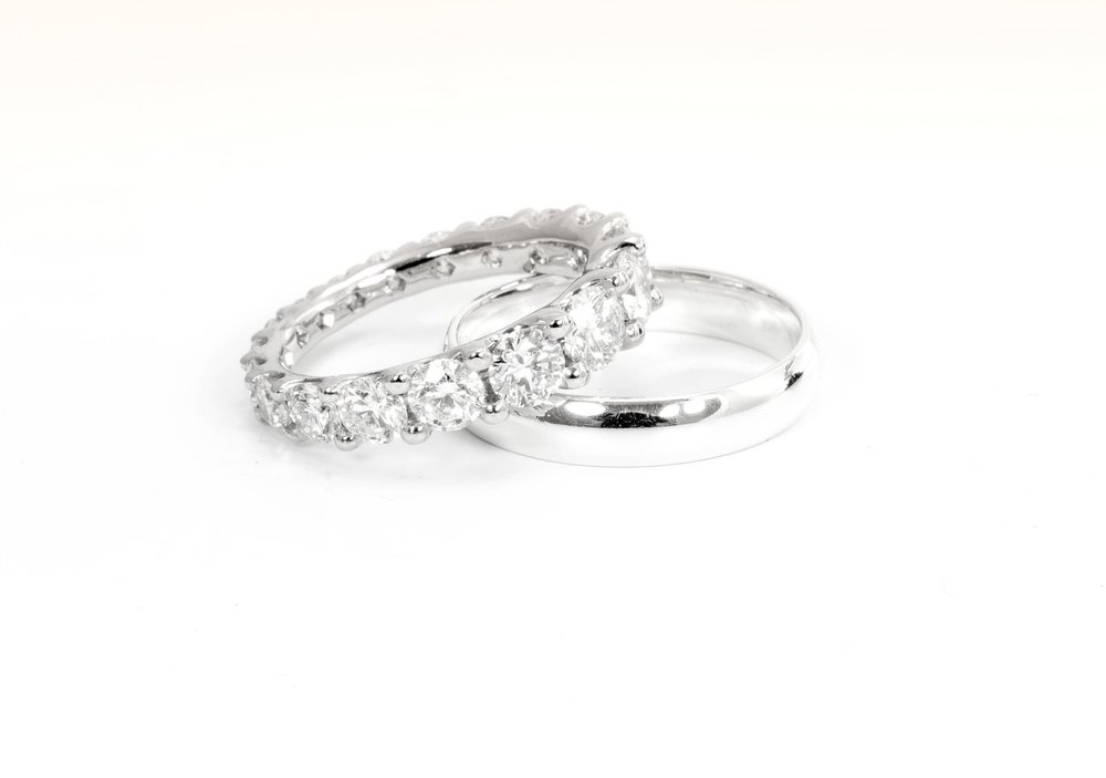 A graduated size diamond claw set full eternity ring. Big stones around the back can be uncomfortable but no-one minds them at the front! Made in Chichester, England.