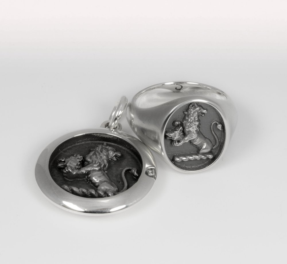 A crest created as a 3d file which has been used in the positive and cast as a silver pendant and ring.