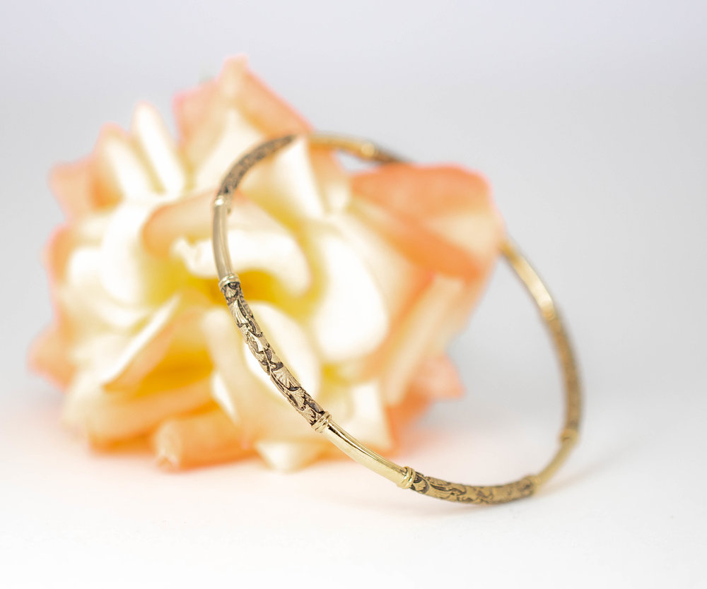 Gold slave bangle with ginko leaf decoration. Made in Chichester, England