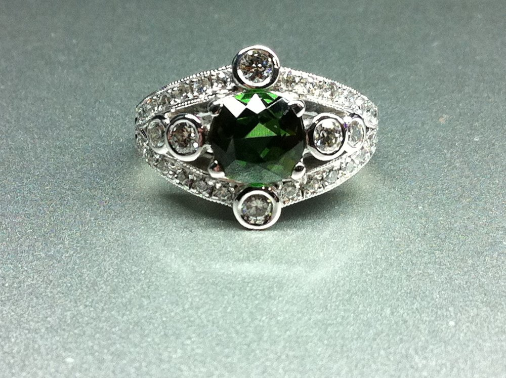 Green tourmaline and diamond wide band ring. Made in Chichester, England.