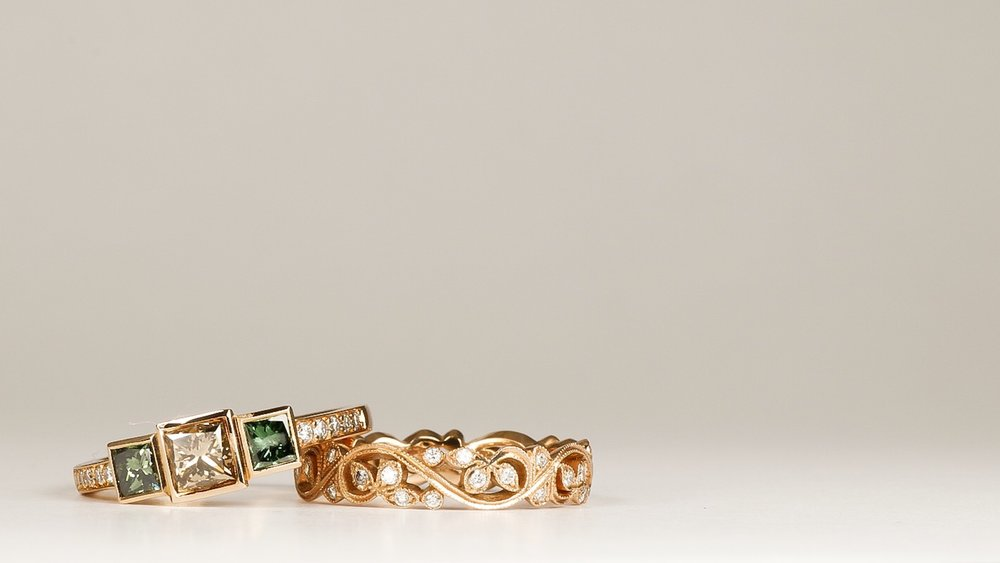 Copy of White, brown and treated green diamond 3 stone ring with foliate diamond set band. Made in Chichester, England.
