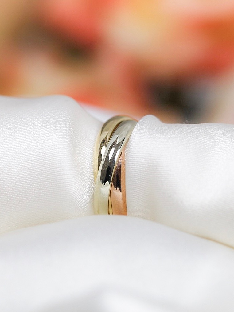 Russian style wedding ring containing the three colour golds, Yellow, White and Rose.