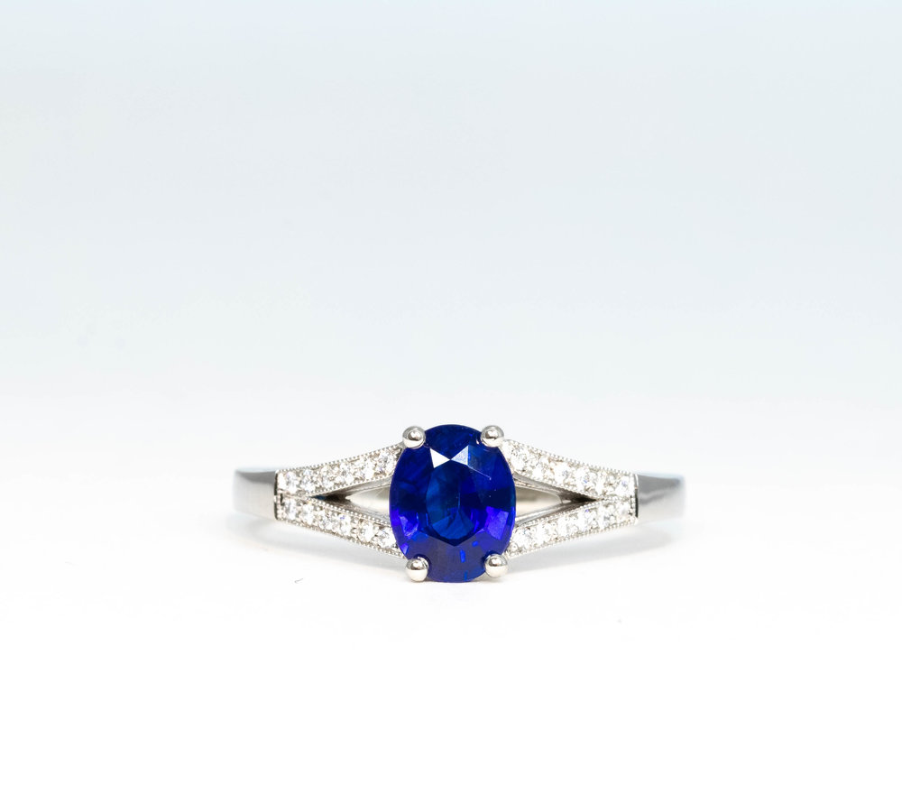 0.99ct deep blue sapphire and diamond set split shoulder ring. Made in Chichester, England.