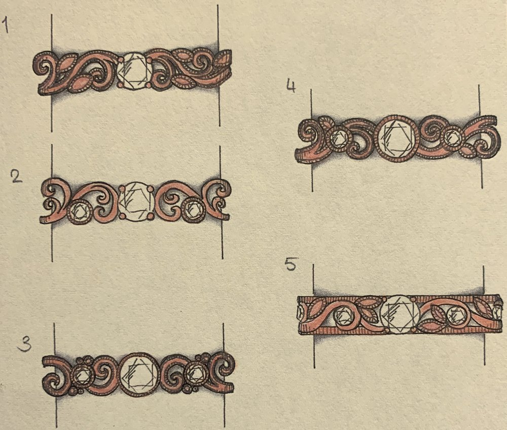 Foliate  scroll variations but with larger centre stone.