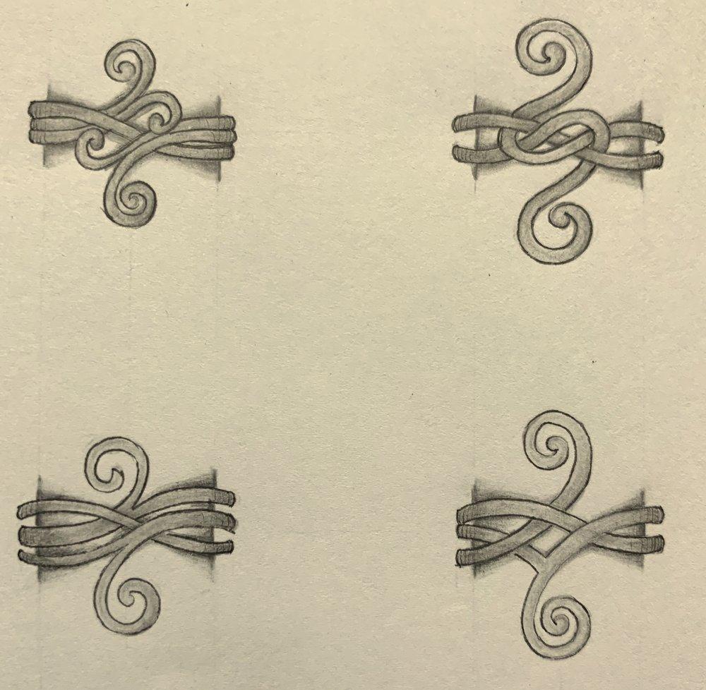 Pretty, interwoven wirework scroll rings.
