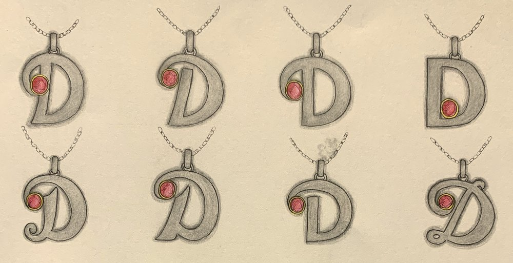 Variations for an initial D pendant with ruby set.