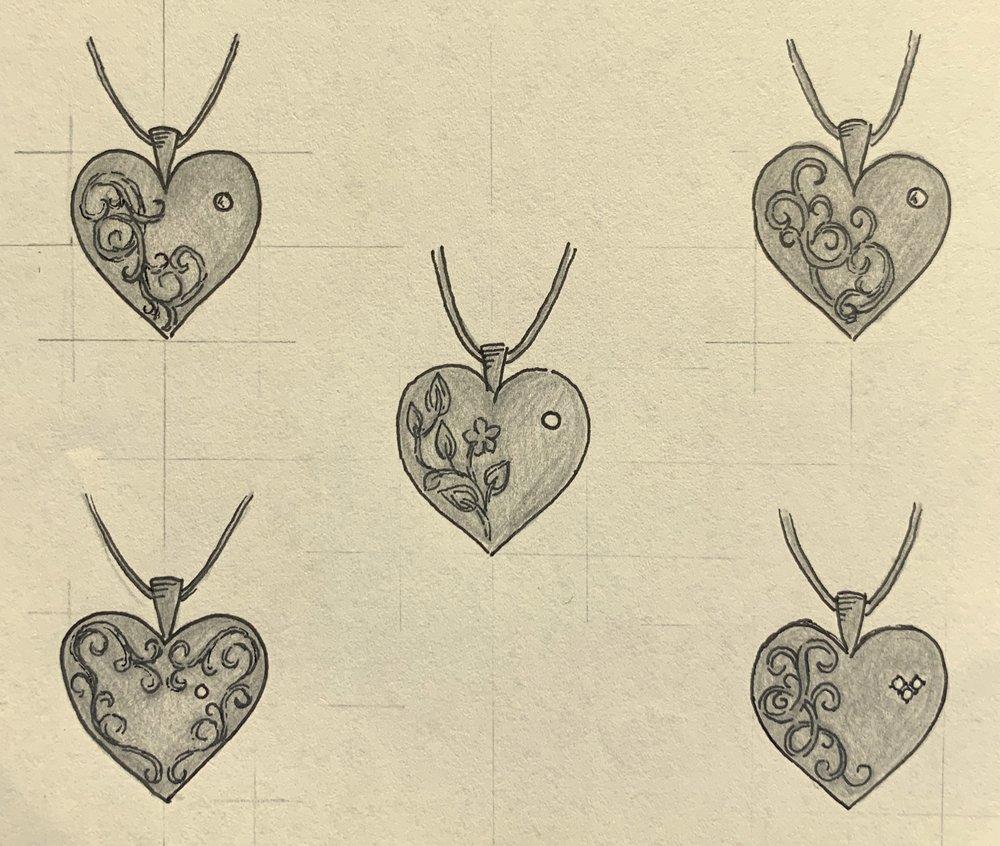 Foliate or simpler scrollwork decoration for diamond set heart locket.