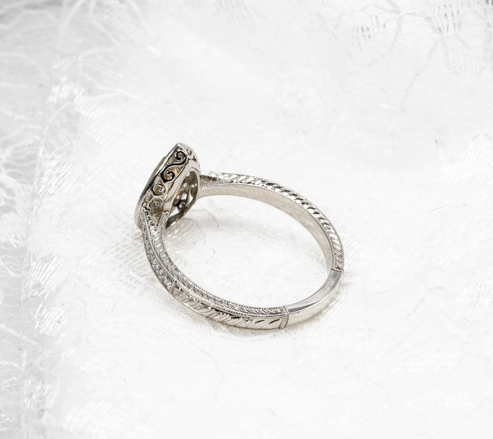 Some nice hand engraving on this ring by one of our diamond setters. Yellow pear shaped diamond cluster, mounted in platinum. Made in Chichester, England.