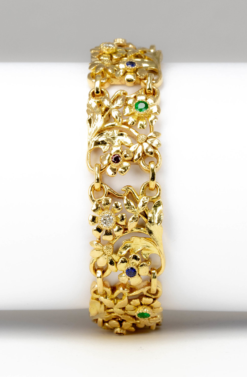 Gold foliate multi gem and diamond set panel bracelet. made in Chichester, England.