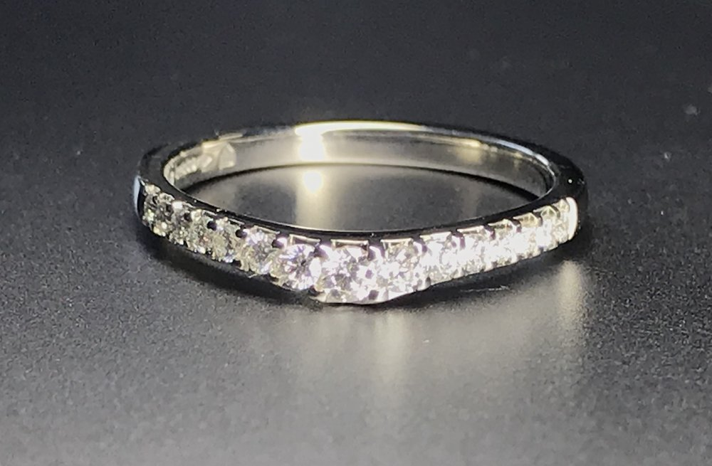 Copy of Platinum graduated and shaped cut away set diamond wedding ring
