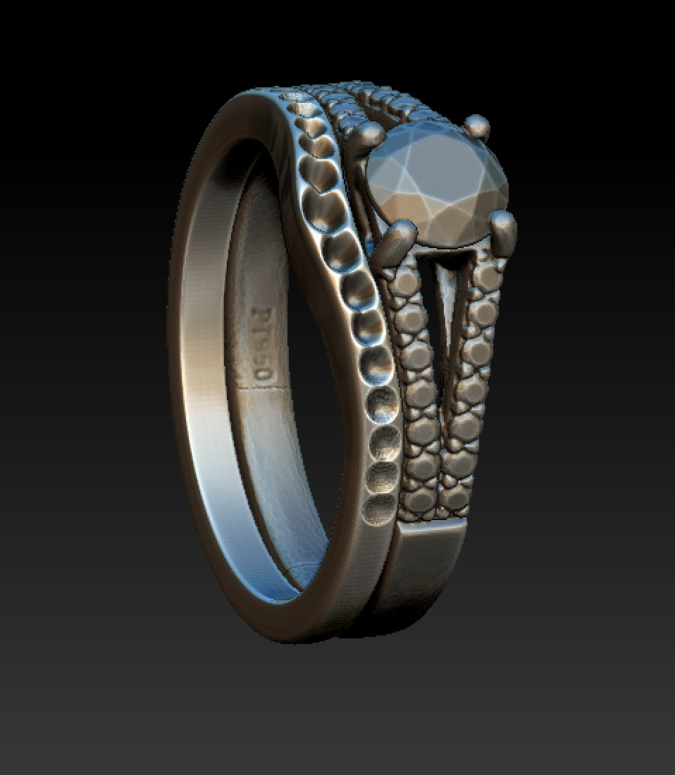 Copy of CAD work for a shaped and fitted diamond wedding ring around a 3d scanned diamond engagement ring.