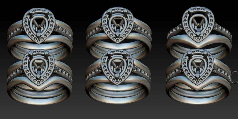 Copy of Options with slight variations on one or a pair of wedding rings to fit with pear shaped diamond cluster.