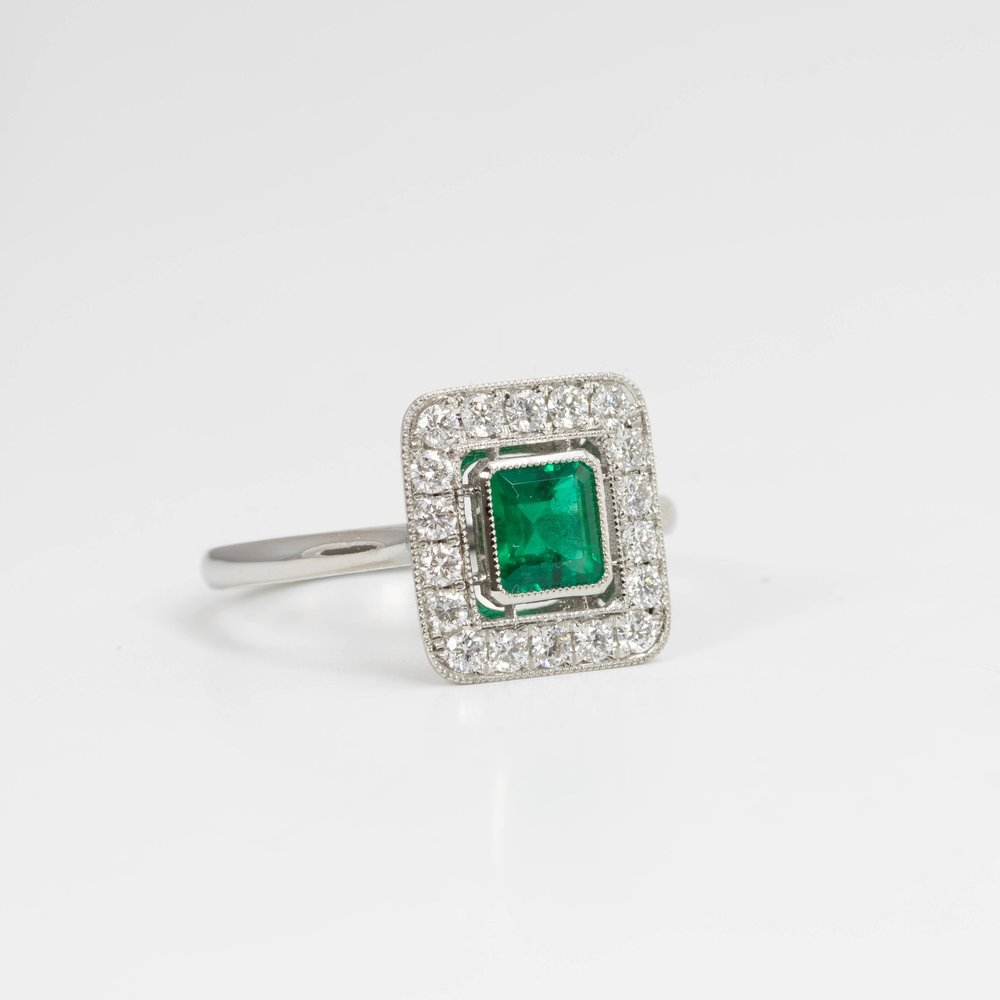 Pretty emerald and diamond set square cluster ring. Made in Chichester England.