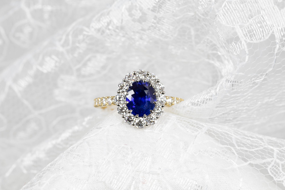 1.95ct Sri Lankan oval sapphire with platinum and 18ct yellow gold mount. Diamond weight 1.08ct total. Made in Chichester, England.