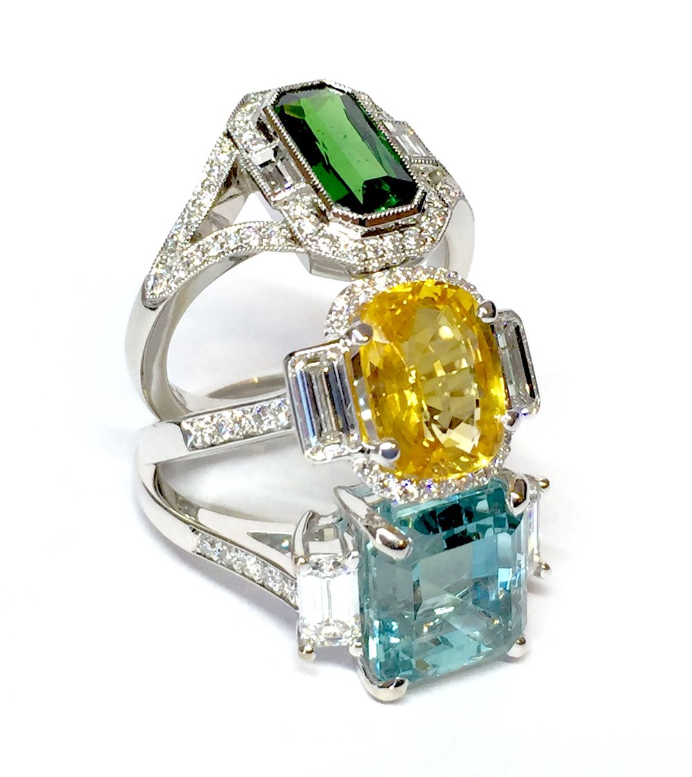 18ct white gold mounted green tourmaline, yellow sapphire and aquamarine set rings. All made in Chichester, England.