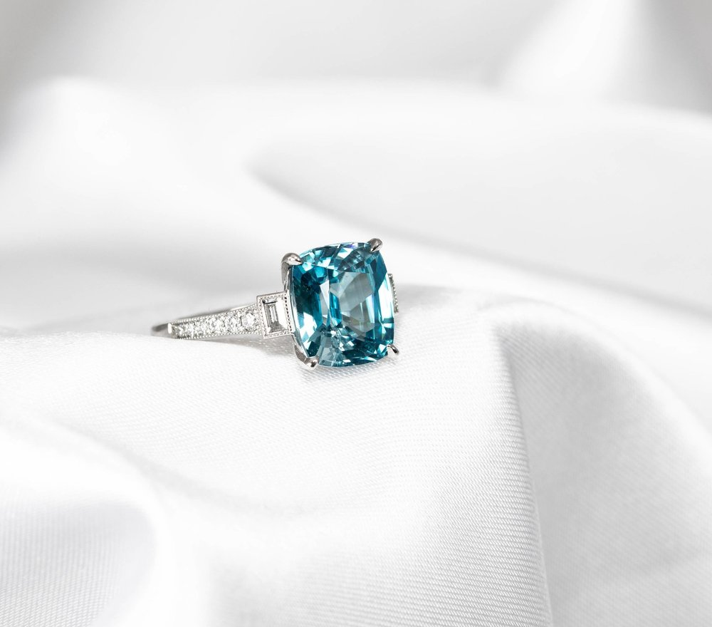 Blue Zircon, baguette and round diamond set ring. made in Chichester, England.
