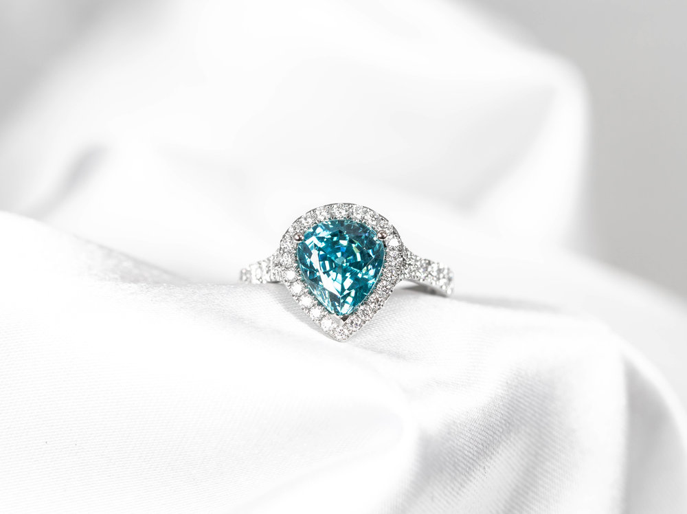 Platinum mounted pear shaped blue zircon and diamond cluster ring. Made in Chichester, England.