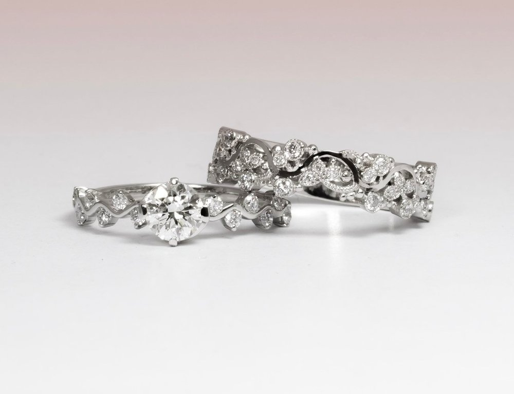 Here we made the fitted diamond set foliate scroll wedding band that had to match a wavy and diamond set band on the engagement ring. You can just see the recess which allows the two rings to fit together whilst still maintaining the wave pattern through both the rings.