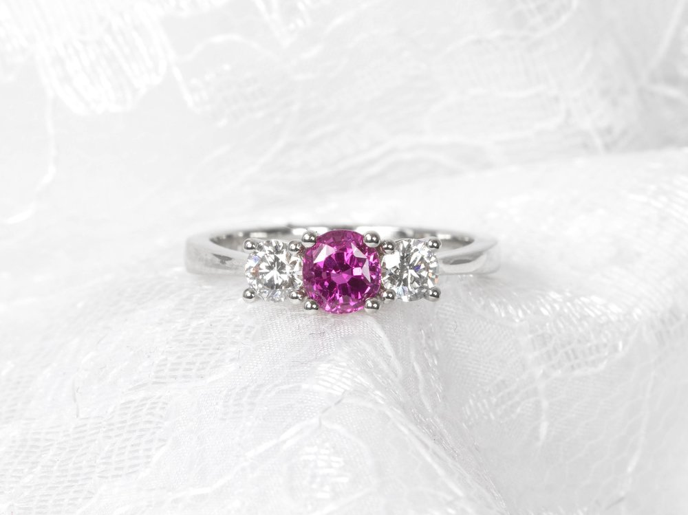 Platinum mounted pink sapphire and diamond classic 3 stone ring. Made in Chichester, England.