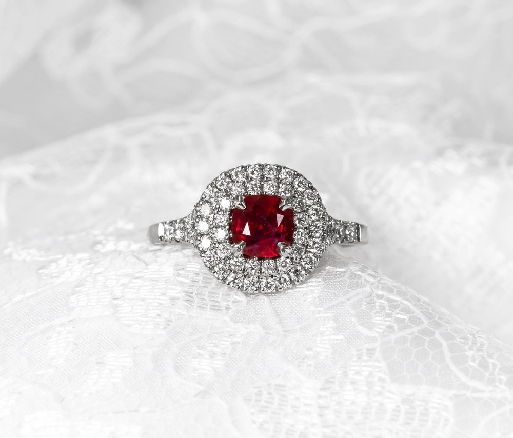 Platinum mounted rounded cushion shaped double row halo cluster ring with split diamond set shoulders. Made in Chichester, England.