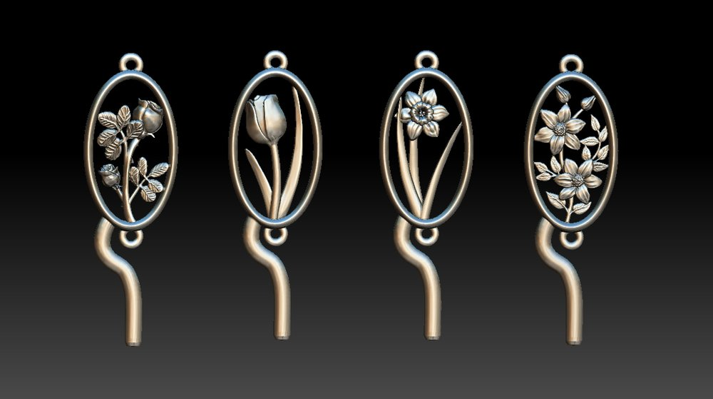 """The four finished 3d modelled flower links with rings attached and """"sprues"""" attached, used for feeding the molten gold into the moulds."""