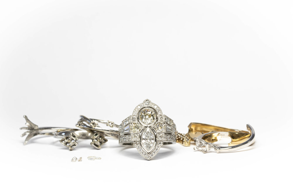 The completed ring amongst the old mounts from which the diamonds were removed.