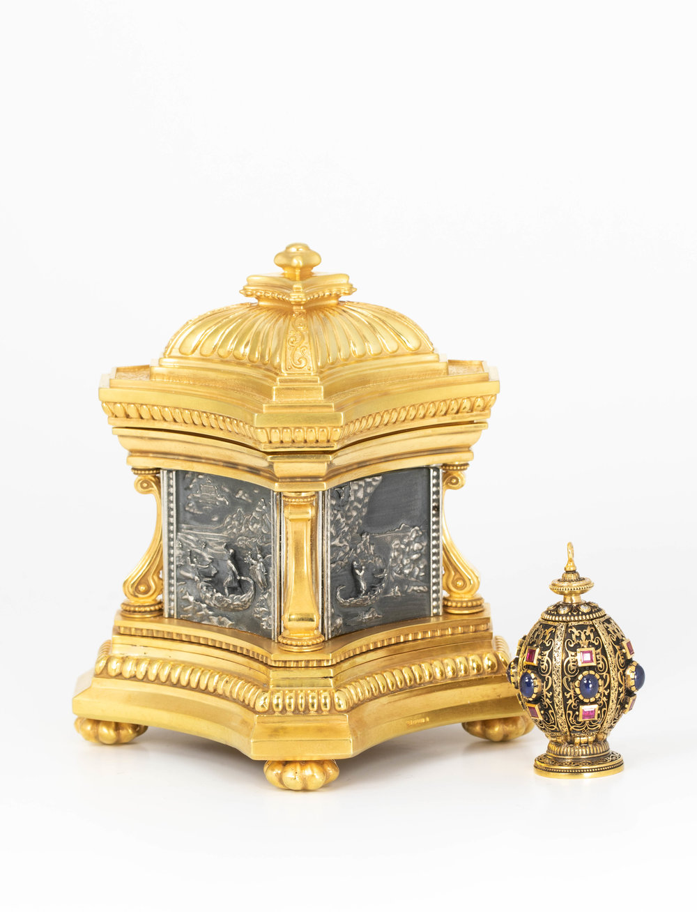"""Gold pomander set with rubies, sapphires and diamonds together with a silver and silver gilt """"Journey of Life casket"""". Both made in Chichester, England."""