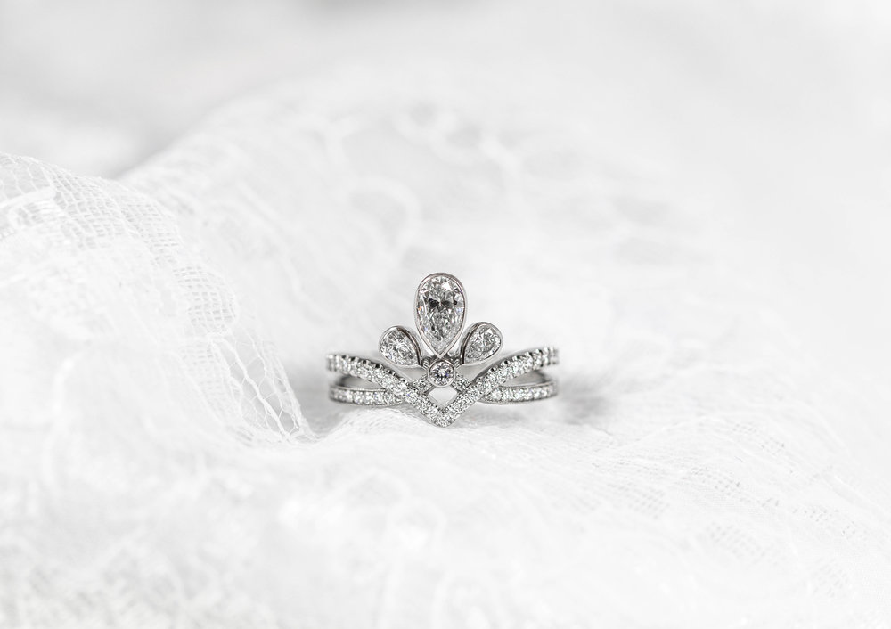 Platinum mounted pear shaped and round cut diamond set tiara ring. This ring is shown being 3d scanned to allow us to make a shaped and fitted diamond set wedding ring -  Click here  to see the scanning video and  here  to see the cad work video.