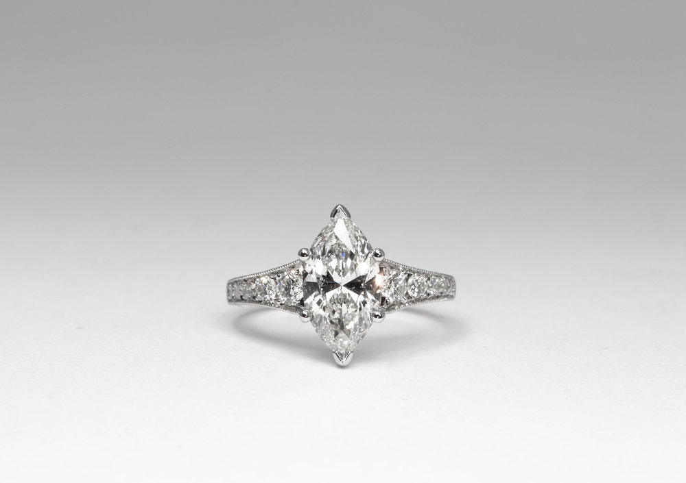 2.05ct Marquise cut diamond solitaire with graduated grain set diamond shoulders. Made in Chichester, England.