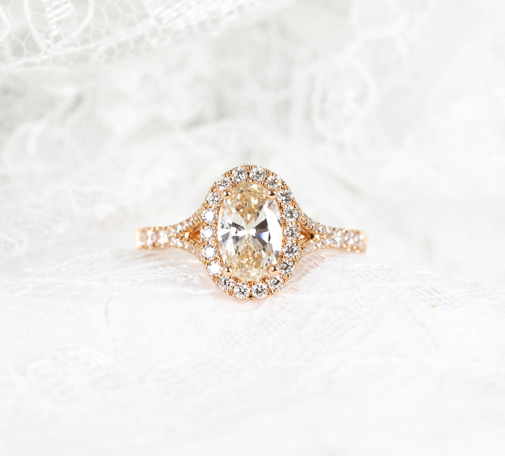 18ct rose gold mounted oval light brown / yellow tinted 0.93ct oval brilliant diamond with diamond border. Made in Chichester, England.