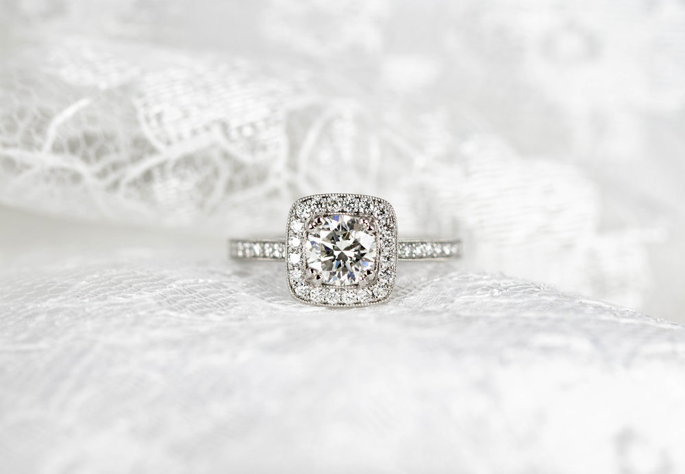 Platinum mounted 0.69ct customers diamond bespoke cushion cluster ring with millegrain edge decoration. Made in Chichester, England.