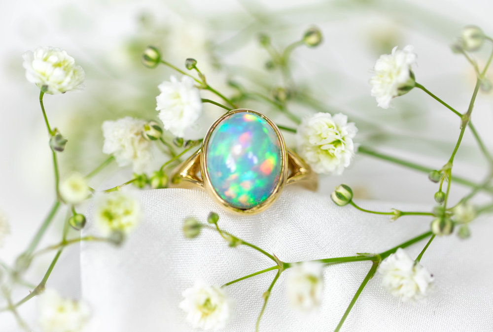 Ethiopian opal in 9ct yellow gold split shoulder mount. Made in Chichester. England.