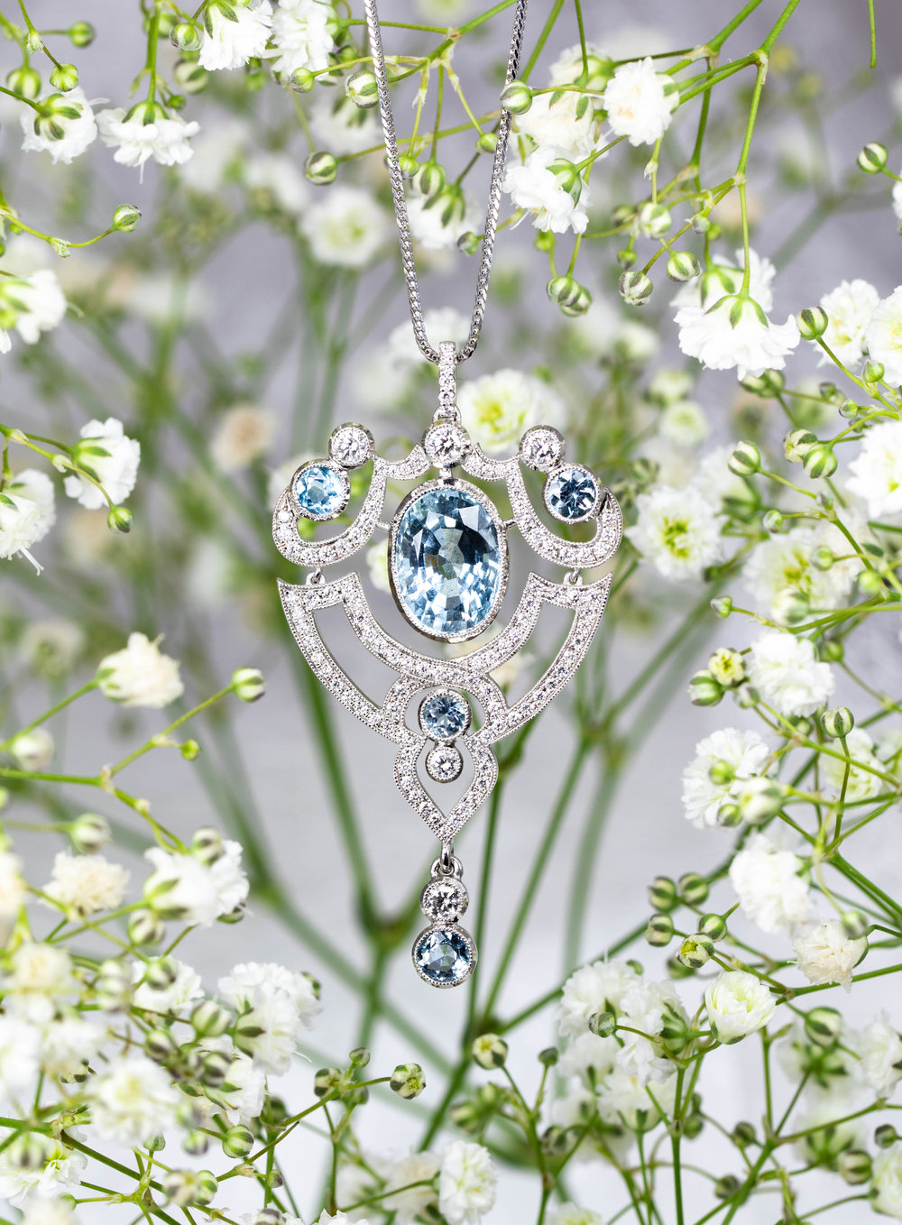 Belle Epoque style aquamarine and diamond set pendant. Made in Chichester, England.