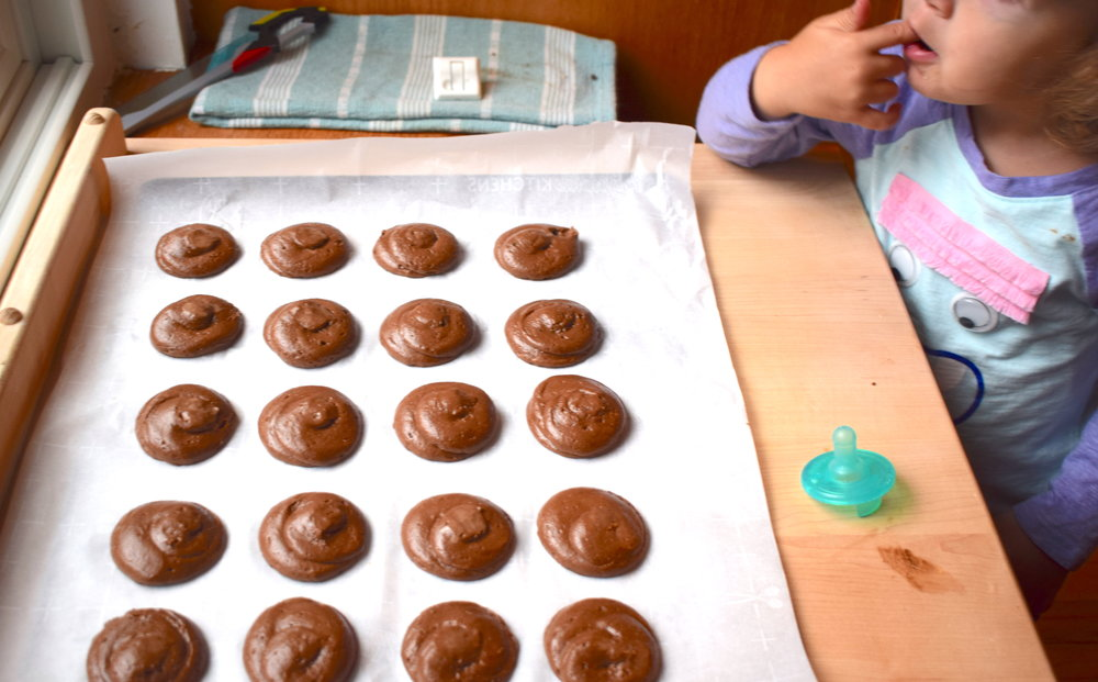 Once we piped out the cookies, we dabbed the peak with a wet finger to smooth it down so the tops (that will become the bottoms) wouldn't have a pointy end.